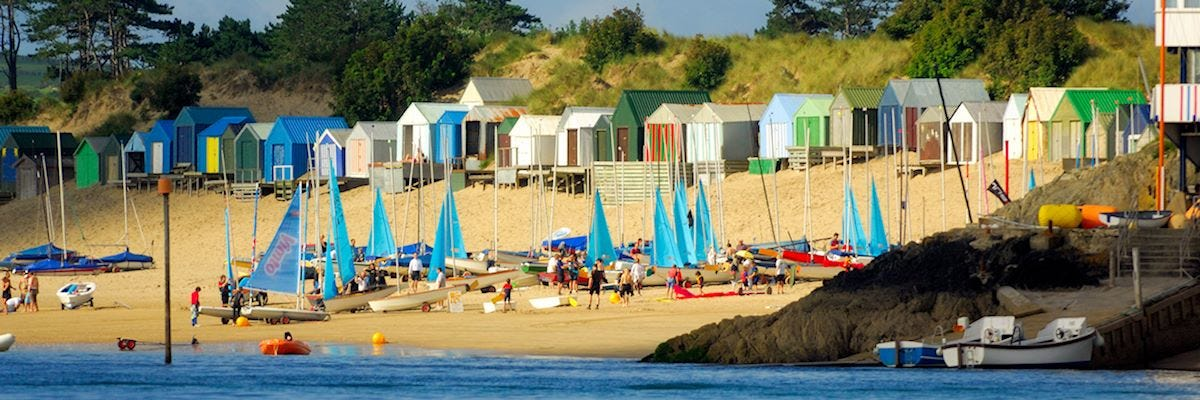Abersoch Holiday Homes. Busy beach scene.