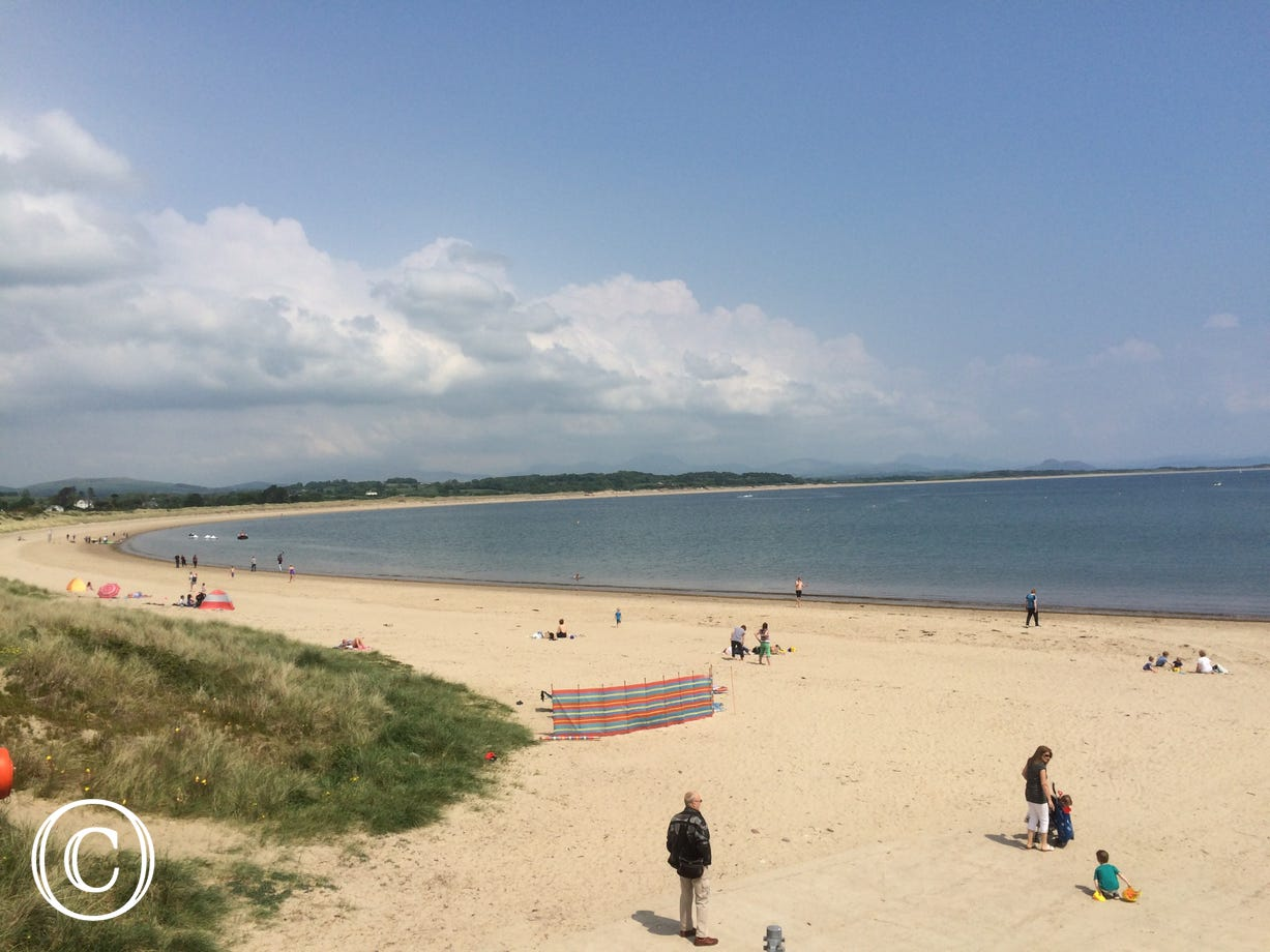 Pwllheli Beach leading to Abererch Beach in the distance