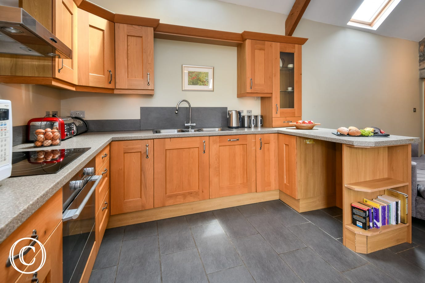 Oak kitchen with electric oven, fridge-freezer, dishwasher & microwave