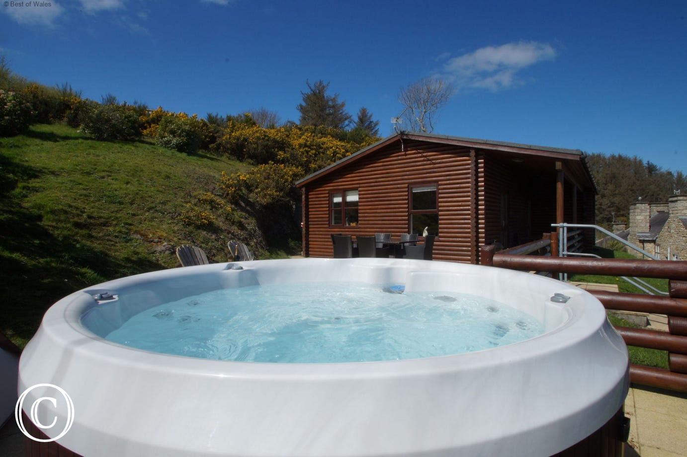 Relax for hours on the patio at Gorwel Log Cabin North Wales