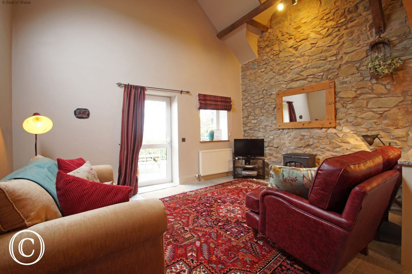 Llyn Peninsula accommodation - living area leading out to the patio.
