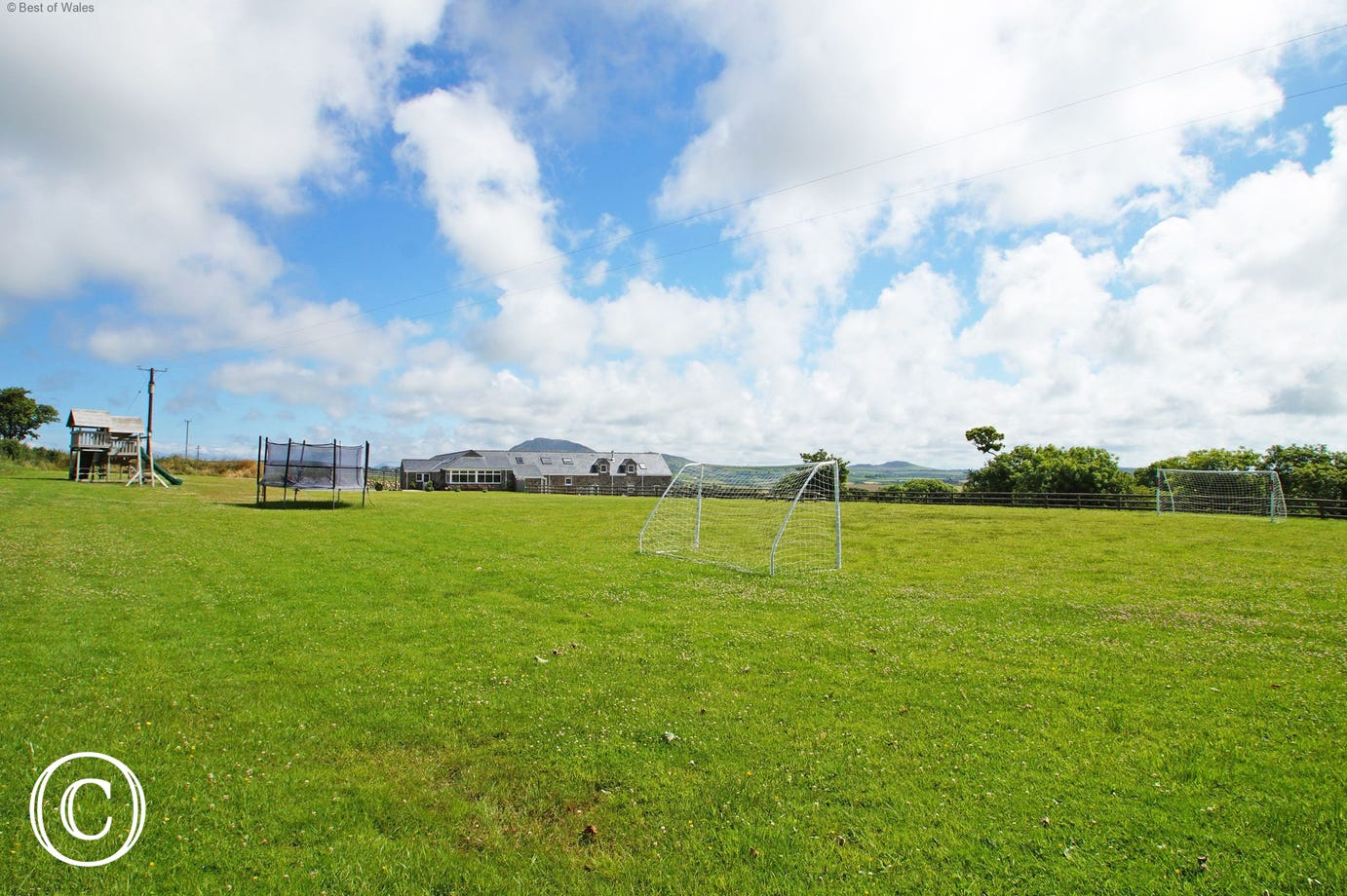 Large communal playing field includes football goals & climbing frame