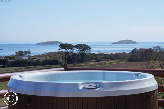 Stunning view from the hot tub towards the coast and Abersoch
