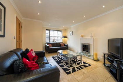 Living room benefits from Sky TV and contemporary electric fire