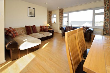 Large windows from the living room give panoramic views of Abersoch